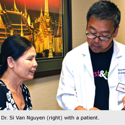 Dr. Si Van Nguyen (right) with a patient.