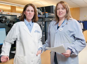Dr. Stacy Melanson (left) with Alicia Darragh, senior medical technologist, toxicology. The lab at Brigham and Women's is formalizing a pain toxicology consultative service. It's doing five to 10 such consults monthly now, mostly with primary care physicians.