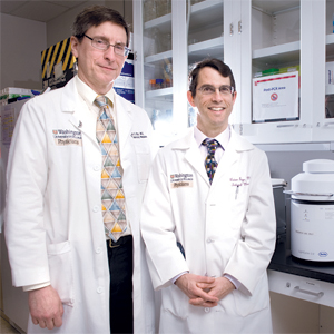 <em><strong>For warfarin pharmacogenetics testing</strong>, much rests on the results of the GIFT and COAG multicentered trials. Below, at Washington University, Dr. Charles Eby (left), medical director of the central labs for the trials, and Dr. Brian Gage, principal investigator for GIFT.</em>