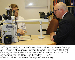 Jeffrey Arnold, MD, AP/CP resident, Albert Einstein College of Medicine of Yeshiva University and Montefiore Medical Center, explains the importance of a test as a successful screening tool to Rep. Joe Crowley (D-N.Y.). (Credit: Albert Einstein College of Medicine).