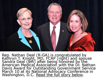 Rep. Nathan Deal (R-GA) is congratulated by Kathryn T. Knight, MD, FCAP (right) and spouse Sandra Deal (left) after being honored by the American Medical Association with the Dr. Nathan Davis Award for Outstanding Government Service March 10 at its National Advocacy Conference in Washington, D.C.