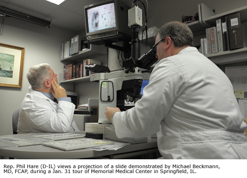 Rep. Phil Hare (D-IL) (left) views a projection of slide demonstrated by Michael Beckmann, MD, FCAP during a Jan. 31 tour of Memorial Medical Center in Springfield, IL.