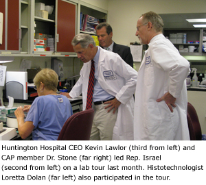 Huntington Hospital CEO Kevin Lawlor (third from left) and CAP member Dr. Stone (far right) led Rep. Israel (second from left) on a lab tour last month.