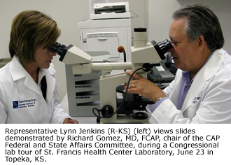 Representative Lynn Jenkins (R-KS) (left) views slides demonstrated by Richard Gomez, MD, FCAP, chair of the CAP Federal and State Affairs Committee, during a Congressional lab tour of St. Francis Health Center Laboratory June 23 in Topeka, KS.