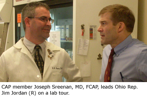 CAP member Joseph Sreenan, MD, FCAP, leads Ohio Rep. Jim Jordan  (R) on a lab tour.