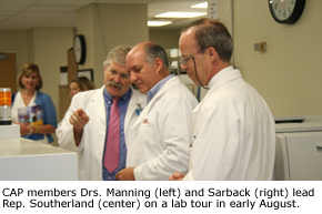CAP members Drs. Manning and Sarback lead Rep. Southerland on a lab tour in early August.